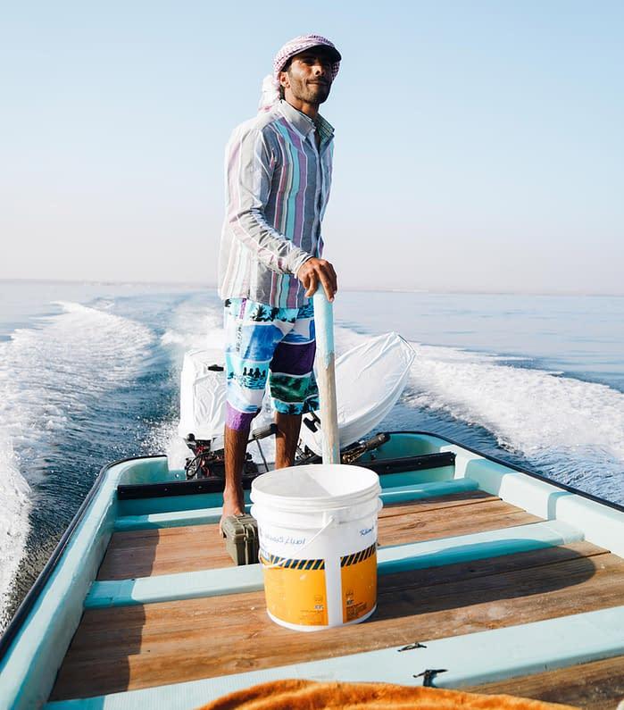 Omani Fisherman on His Boat